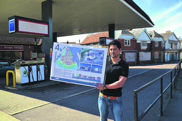 This Is Wiltshire: Alex Dean, with the plan for homes on the Bridge Garage site, which have now been approved, along with ones for derelict cottages