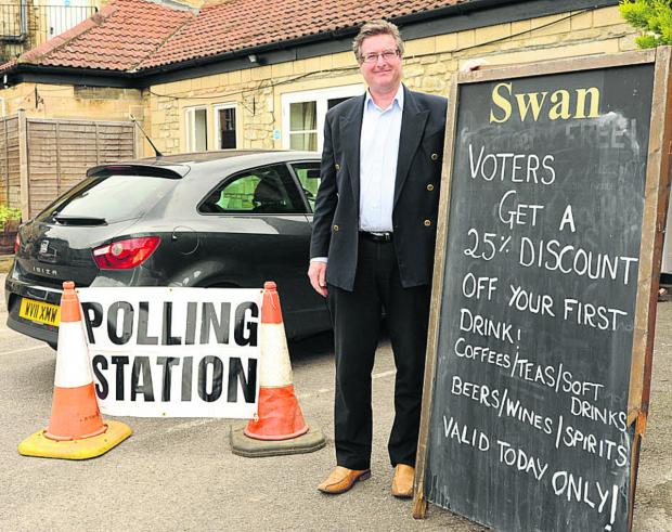This Is Wiltshire: James Sullian Tailyour is giving a discount at the Swan Hotel, Bradford on Avon, which is a polling station for the European Parliamentary elections today