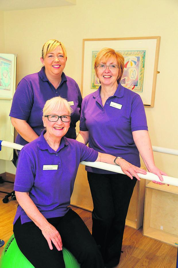 This Is Wiltshire: From left, Prospect Hospice physiotherapist Dorinda Moffatt, team leader Anne Macmillan and Anne Hughes, occupational therapist; below, Andy Tidey with Dorinda