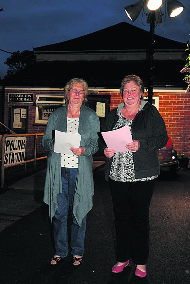 This Is Wiltshire: Polling clerk Eileen Eggleton and her sister Dianne Pirrie, presiding officer, help make sure voting can continue at Bulkington last night