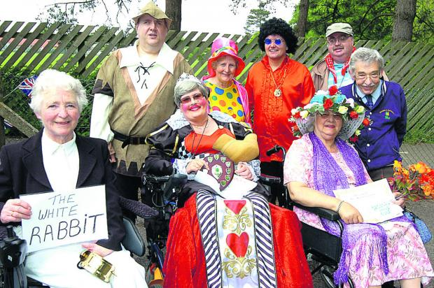 This Is Wiltshire: Devizes PHAB Club push and walk. Pictured far right is Michael Braund, organiser and transport officer for PHAB, with all of the fancy dress winners