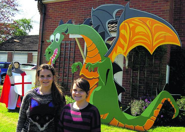 This Is Wiltshire: Laura and Anabel at the Urchfont Scarecrow Festival with winning creation George And The Dragon            (PM1227) By Paul Morris