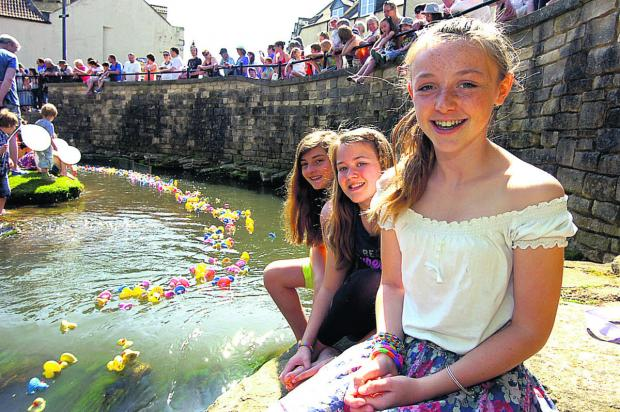 This Is Wiltshire: Ery, Charlotte and Isabelle in a prime position to watch Calne Duck Race