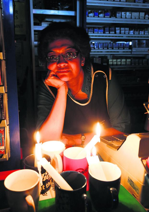 This Is Wiltshire: Ilpa Patel, who runs Victoria News in Victoria Road, is angry after the electricity went off in parts of Old Town Swindon on Saturday. Picture: STUART HARRISON