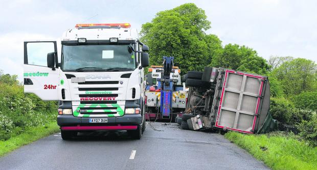 This Is Wiltshire: A lorry overturned on the B4005 between Wroughton and Chiseldon on Saturday. Picture: STUART HARRISON