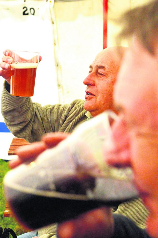 This Is Wiltshire: Mel Denton and Allan Edgerton enjoy a pint at the beer festival. Pictures: THOMAS KELSEY