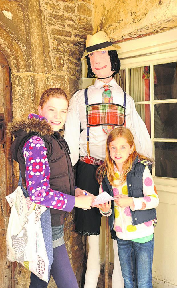 This Is Wiltshire: Ella, 11, and Holly, eight, of Chippenham on the scarecrow trail at Lacock