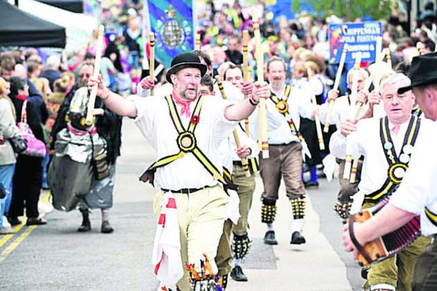 This Is Wiltshire: Chippenham Morris Men in action at the town's folk festival