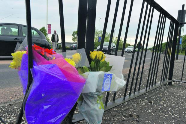 This Is Wiltshire: Flowers at the site of the accident on Thamesdown Drive