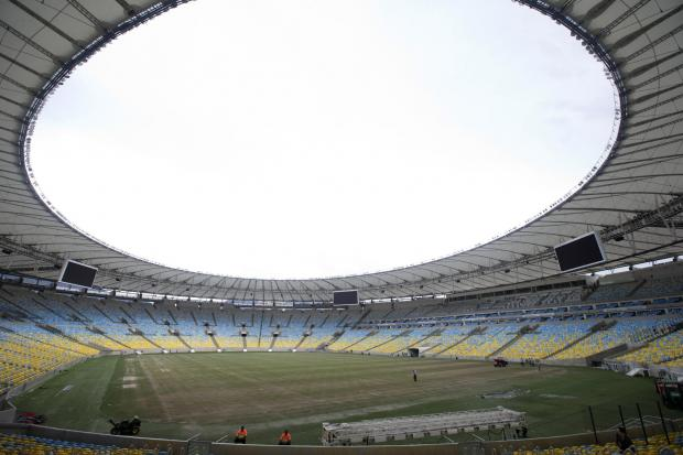 This Is Wiltshire: One of the world's greatest football grounds, Rio's Estadio do Maracana, where next month's World Cup Final will be staged. It has undergone an expensive makeover since the Westerners watched a Rio derby there ten years ago