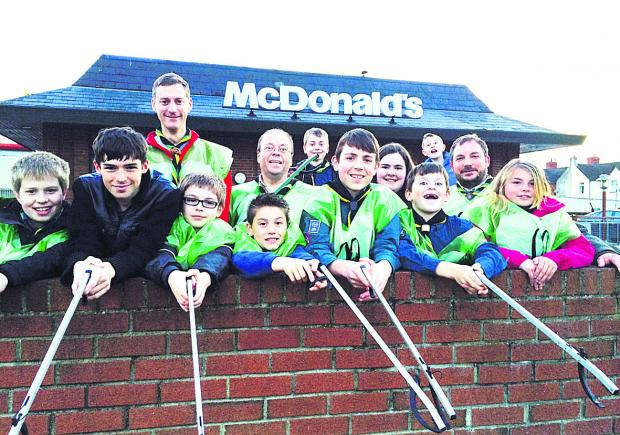 This Is Wiltshire: Crew members from McDonald's restaurant and members of the 1st Lydiard Park Scout group tackle litter