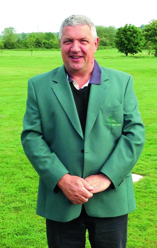 This Is Wiltshire: Last year's winner Colin Driscoll of the Woodbridge Park Golf Club Masters pictured wearing the green jacket