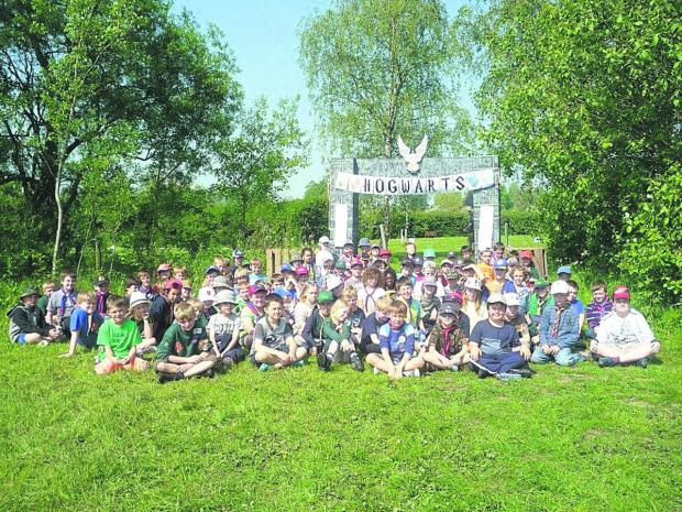 This Is Wiltshire: The cubs at camp under their Hogwarts banner