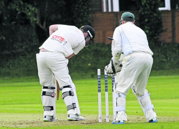 This Is Wiltshire: Wiltshire keeper Adam Miles watches as Wales' TJ Baker is bowled