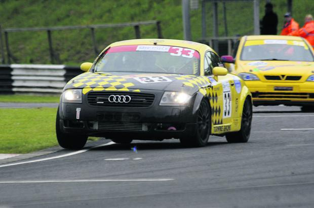 This Is Wiltshire: Tony Hutchings out in front as he wins the Saloon Car Championship at Castle Combe on Monday