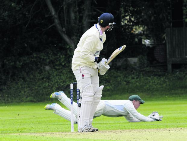 This Is Wiltshire: Wiltshire wicketkeeper Adam Miles dives for a catch against Wales