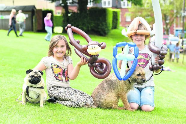 This Is Wiltshire: Ella Beckett with Fabio and Nicholas Beckett with Tedr, with balloon creations made by Dave Hickory