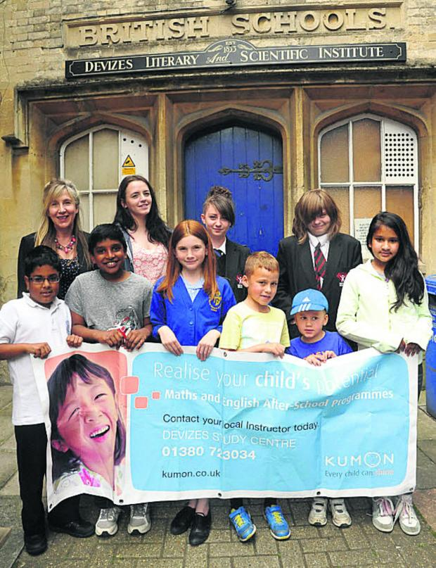 This Is Wiltshire: Helen Wuscher, back left, with some of her pupils at the former British School in Northgate Street