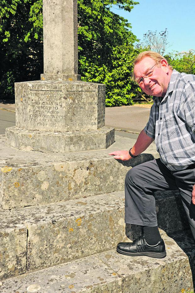 This Is Wiltshire: Cllr Ed Gilby pictured at the memorial