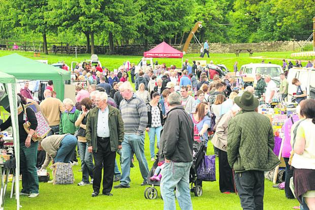 This Is Wiltshire: Crowds at the Victory Field in Bradford on Avon for the car boot sale at the Bradford on Avon Lions  Family Fun Day on Bank Holiday Monday