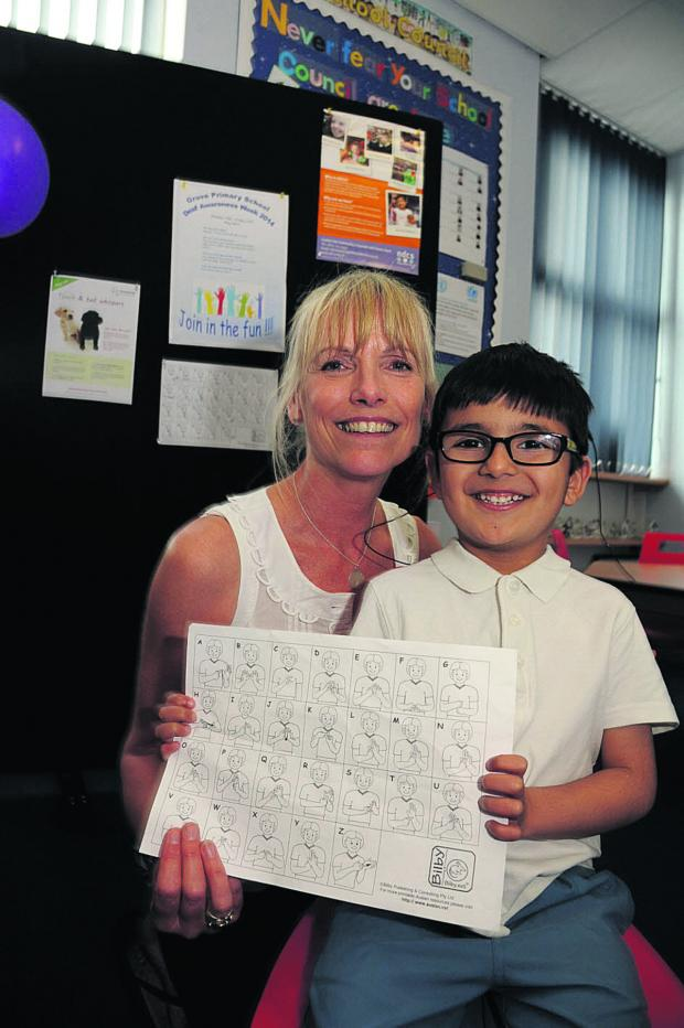 This Is Wiltshire: Liz Poyser, teacher of sign language at Grove School, with deaf pupil Abdullah