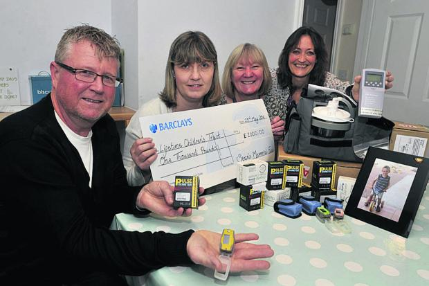 This Is Wiltshire: Yolanda and Steve Turner present £1,000 and medical kit in memory of their son Sean, inset below, to the Lifetime Children's Trust. Receiving the cheque and kit are Brenda Yorston, centre right, and Jackie Macallam, right, of Lifetime Services