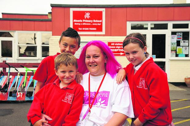 This Is Wiltshire: Aloeric School dinner lady Ollie Gerrish, who dyed her hair pink, with her are son Jack, five, and pupils Josh and Sophie, both nine