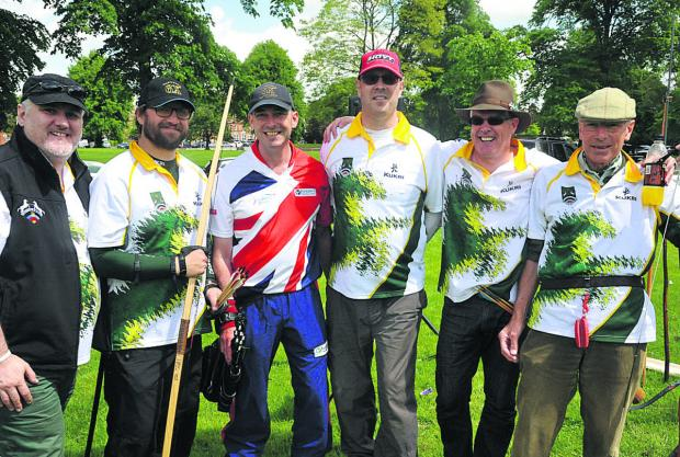 This Is Wiltshire: An archery taster day was held on The Green in Devizes, where people took the chance to try the sport for free. From left are Kris Parker, Martin Page, Mark Rudd, John Bradshaw, Nick Sherman and Leslie Smith