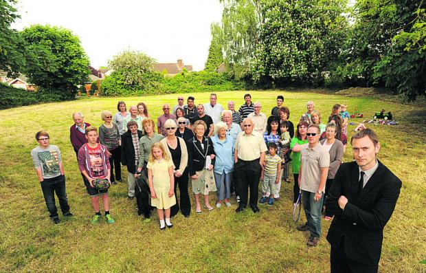 This Is Wiltshire: Paul Adams with other residents at the old tennis courts in Clarendon Road, where a development is proposed