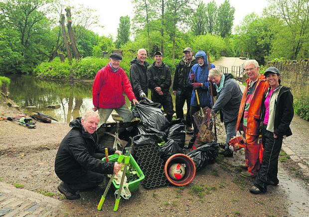 This Is Wiltshire: Town mayor John Potter and fellow volunteers at the river clean