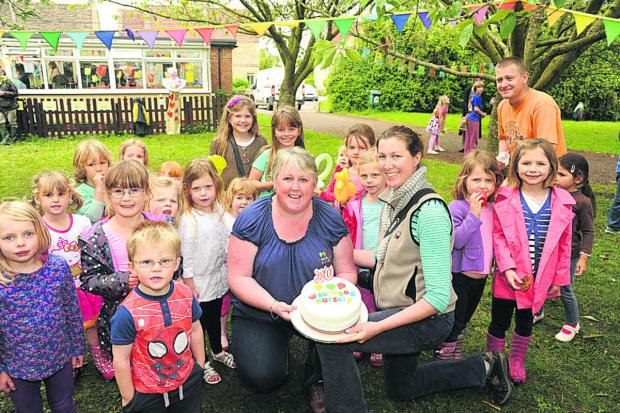 This Is Wiltshire: Dawn Bryant, nursery manager, and Lindsey Millen, joint chair, celebrate Westwood Nursery's 30th birthday with the children