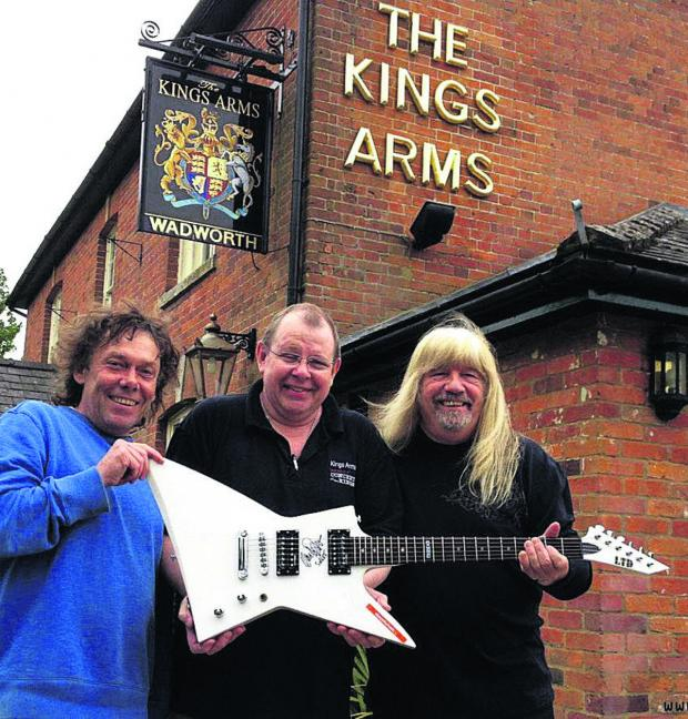 This Is Wiltshire: John Callis, Richard Baulu and Andy Scott with a guitar which is being raffled at the Concert at the Kings charity event tomorrow