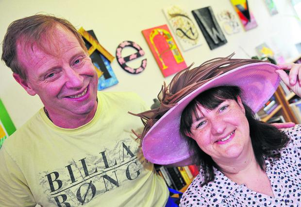 This Is Wiltshire: Lady Lansdowne has donated the hat she wore to the wedding of Prince Charles and Camilla Parker-Bowles to Headway as part of the hats for Headway campaign. Pictured are Mark Jennings and centre manager Jane Weston