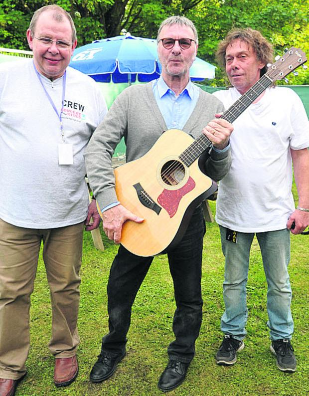 This Is Wiltshire: Richard Baulu, landlord of the King's Arms, Steve Harley with a guitar which was auctioned, and co-organiser John 'Grubby' Callis