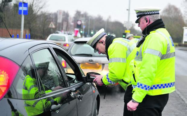 This Is Wiltshire: Police breathalyse a motorist on Wootton Bassett Road, Swindon during a previous campaign