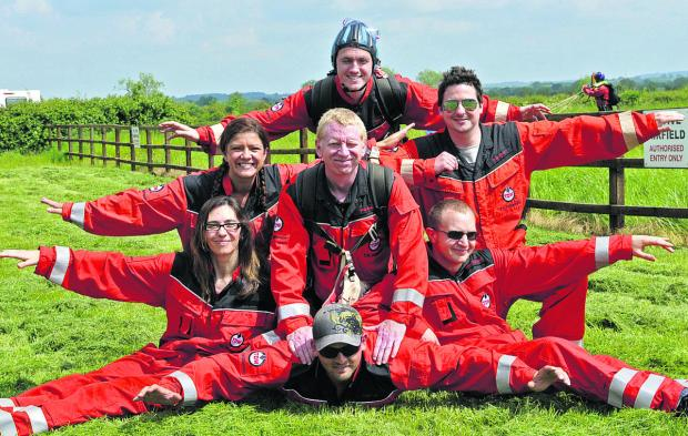 This Is Wiltshire: What goes up... must come down. TD Williamson's intrepid staff members took on a skydive for charity. Pictured clockwise from top, are Gary Mitchard, Mark Duckworth, Andrew Rowland, Jamie Bull, Elena Hamilton, Kerry Willams and Rob Merrett
