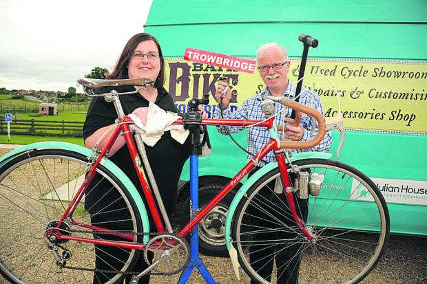 This Is Wiltshire: Jemma Berridge, of Neston Park Farm shop, talks bikes with Cecil Weir of Trowbridge Bike Workshop
