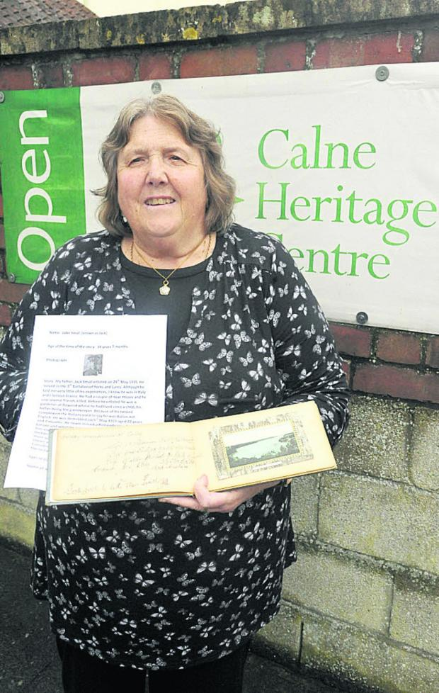 This Is Wiltshire: Sue Boddington with a Calne woman's lodging book filled with signatures of trainee pilots from Yatesbury Camp