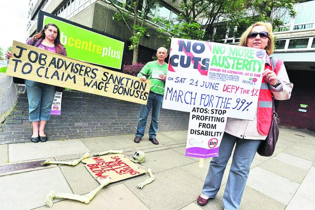 This Is Wiltshire: Angel Grace and Livio and Jenny Pavone stage their protest at the job centre