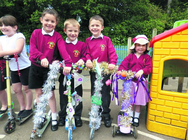 This Is Wiltshire: Children at Queen's Crescent Primary School took part in a 'Bling Your School Journey Day'