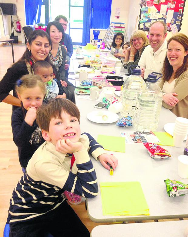 This Is Wiltshire: Families, and MP Justin Tomlinson, gather at the Big Lunch event  in North Swindon