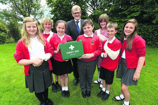 This Is Wiltshire: From left, Angharad, Archie, Jessica, headteacher John Barlow, Andrew, Sophia, Oli
