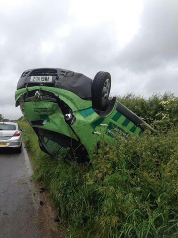 This Is Wiltshire: Driver's lucky escape after flipping onto roof