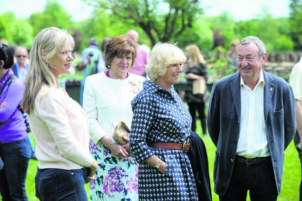This Is Wiltshire: From left, Annette Mason, the Duchess of Cornwall and Nick Mason at last year's event.