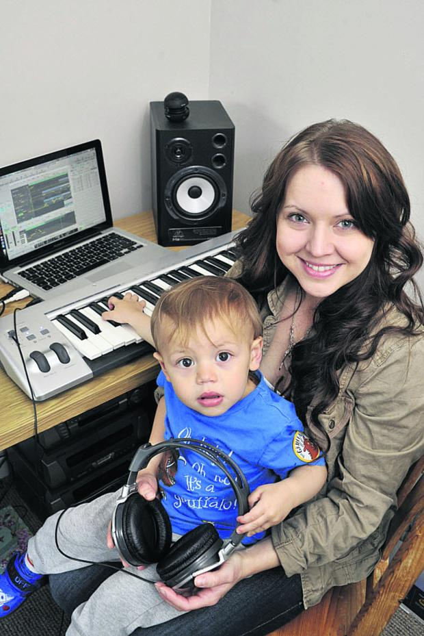 This Is Wiltshire: Part-time music producer Alexis Turvey of Melksham in her bedroom studio, with her son Luis Connors