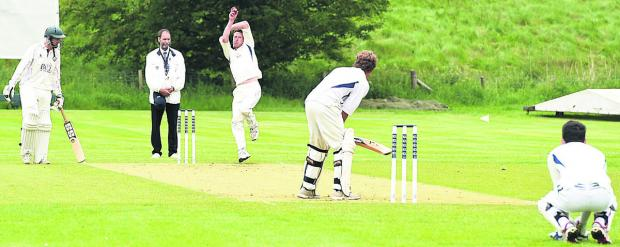 This Is Wiltshire: Heytesbury & Sutton Veny bowler Justin Wagstaff in action during his side's 50-run defeat at Avebury in Division Three on Saturday