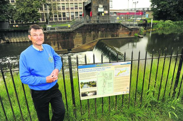 This Is Wiltshire: Chris Coyle with the Wilts & Berks Canal regeneration plan at Melksham weir