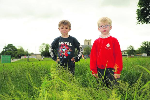 This Is Wiltshire: Sam and Max Griffin were fed up because they could not ride their bikes at the rec because of the long grass. Photo: Trevor Porter (TP49895)