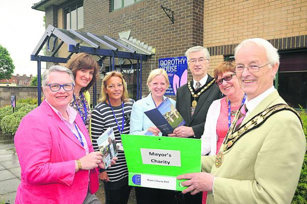 This Is Wiltshire: Trowbridge mayor Cllr Glyn Bridges, right, and deputy mayor Roger Andrews, with Dorothy House's Jayne Chidgey-Clark, Louise Clayton, Val Collins-Thomas, Liz Brown  and Gill Cannon
