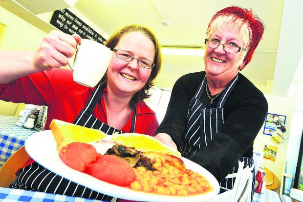 This Is Wiltshire: Hadi Brooks, left, and Jane Davies celebrate The Café's success